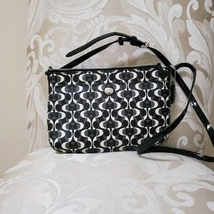 Elegant black and white Coach bag